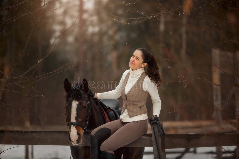 Young beautiful woman with horse outdoor portrait at spring day. Horseback style royalty free stock photography