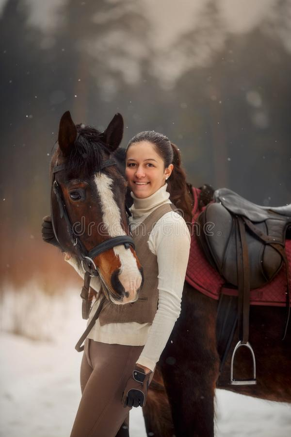 Young beautiful woman with horse outdoor portrait at spring day. Horseback style stock image