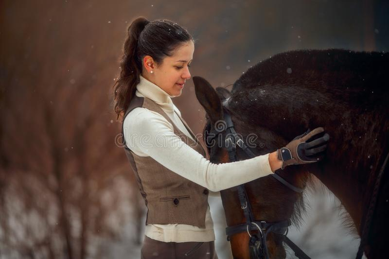 Young beautiful woman with horse outdoor portrait at spring day royalty free stock image
