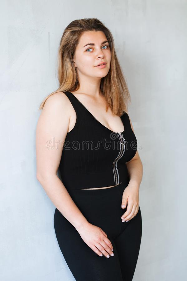 Free Young Beautiful Woman In Black Outfit Royalty Free Stock Image - 148155316