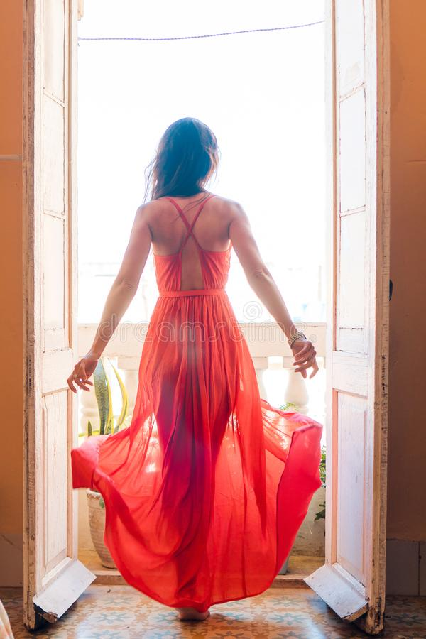 Free Young Beautiful Woman In Red Dress On Old Balcony In Apartment In Old Havana, Cuba. Royalty Free Stock Images - 132163829