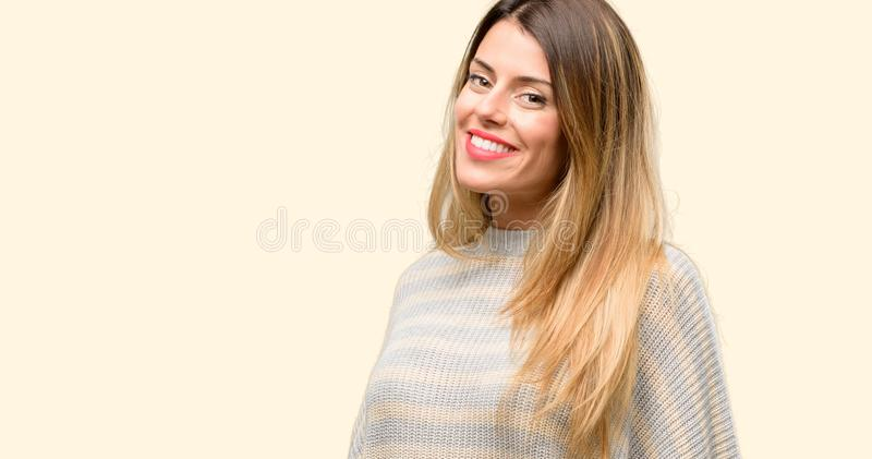 Young beautiful woman isolated over yellow background stock photo