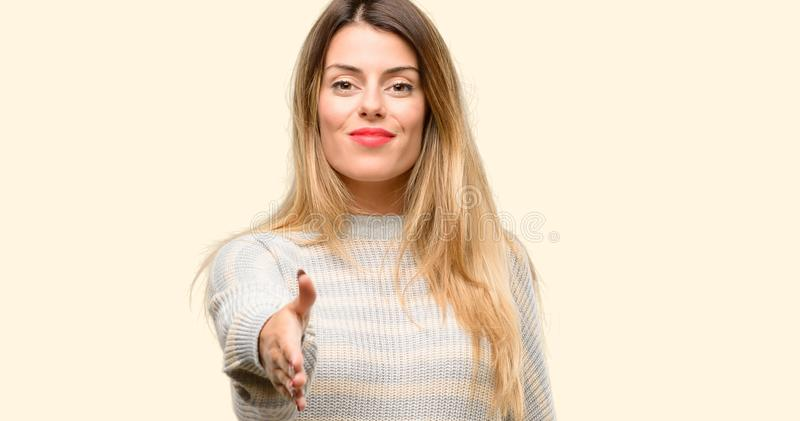 Young beautiful woman isolated over yellow background stock photography