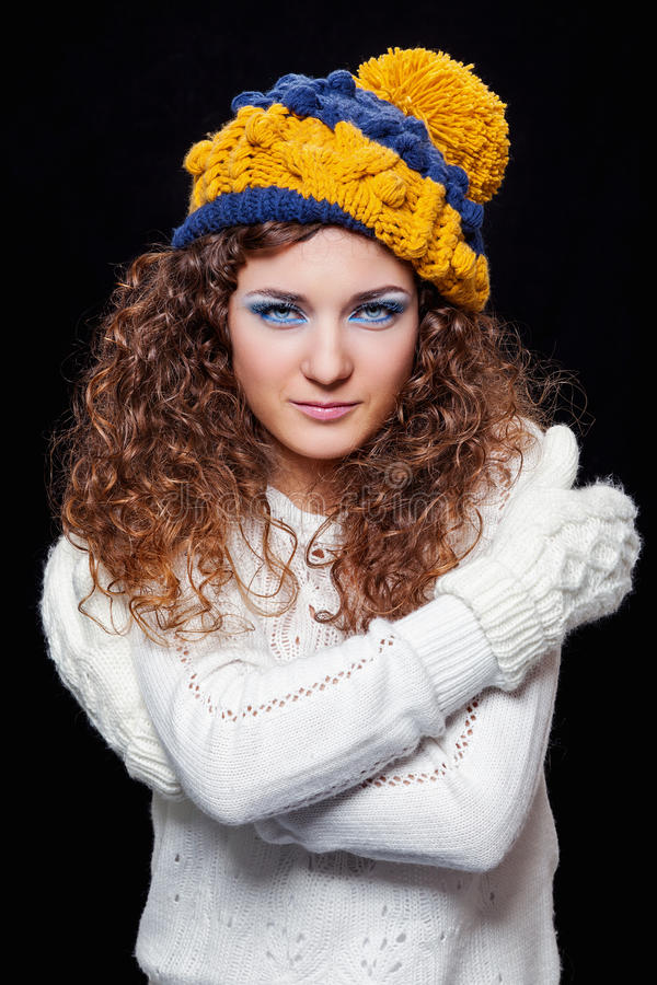 Young beautiful woman in knitted funny hat stock photo