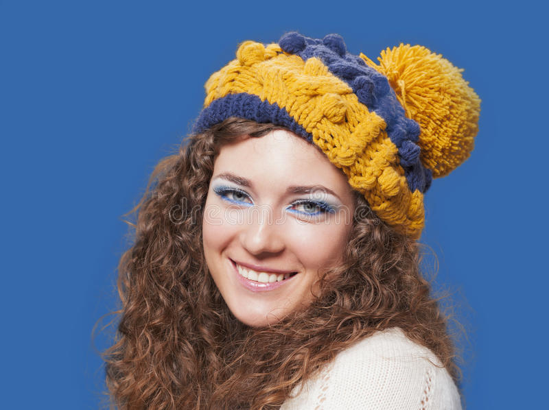 Young beautiful woman in knitted funny hat royalty free stock photography