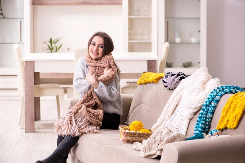 Young beautiful woman knitting at home stock images