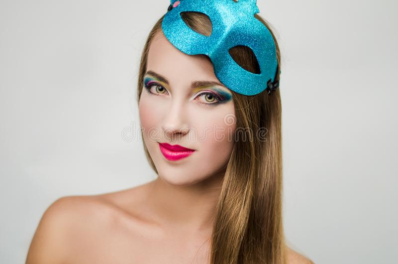 Woman with blue mask stock photo