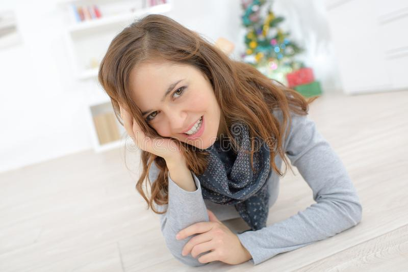 Young beautiful woman laying on floor stock image