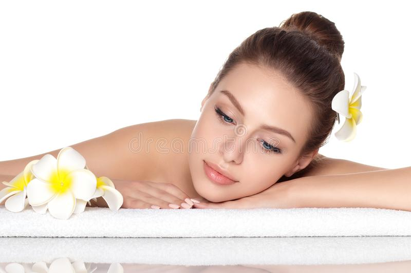 Young beautiful woman laying in spa salon royalty free stock images