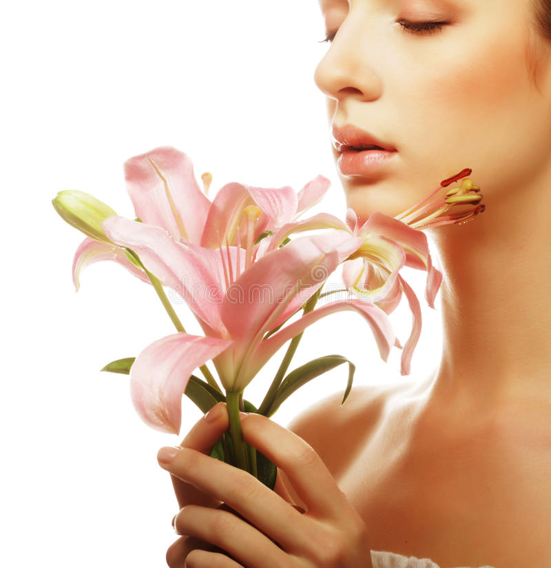 Young beautiful woman with a lily flowers. stock photo