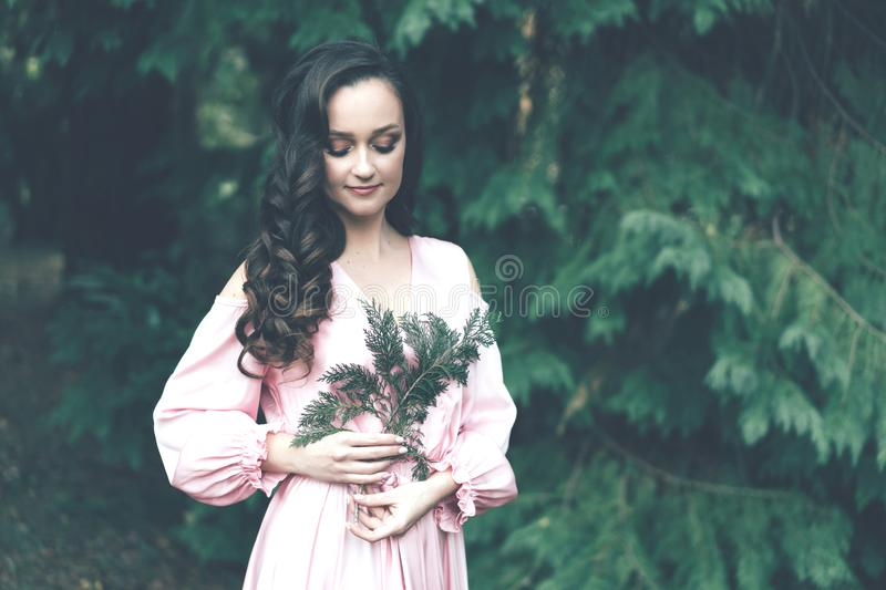 Young woman in a pink dress stock photo