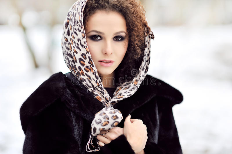 Young beautiful woman with long curly hairs - outdoor fashion po stock image