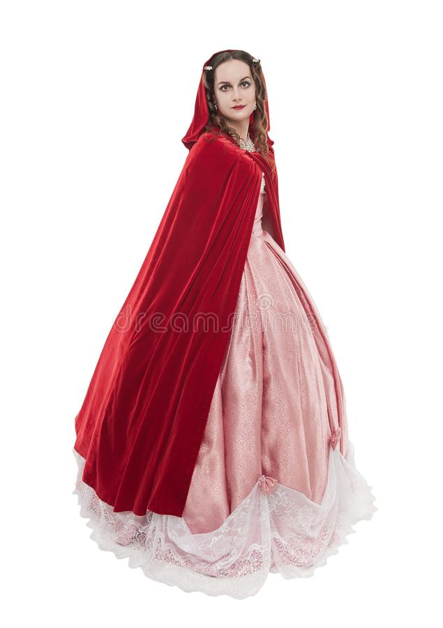 Young beautiful woman in long medieval dress and red cloak isolated stock photography