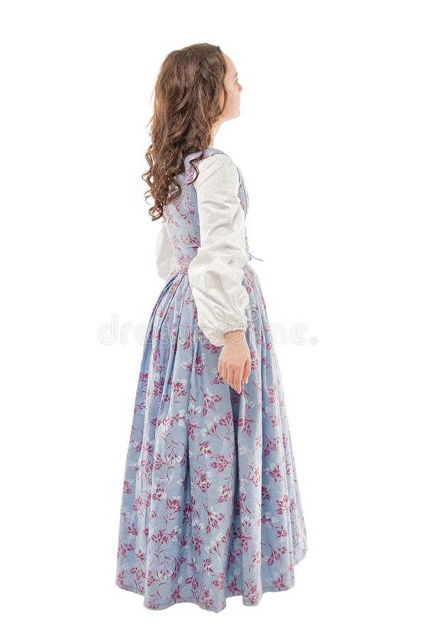 Young beautiful woman in long medieval dress walking isolated. On white royalty free stock photography