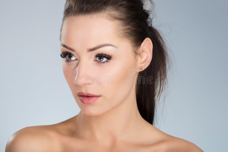 Young beautiful woman looking away stock photo