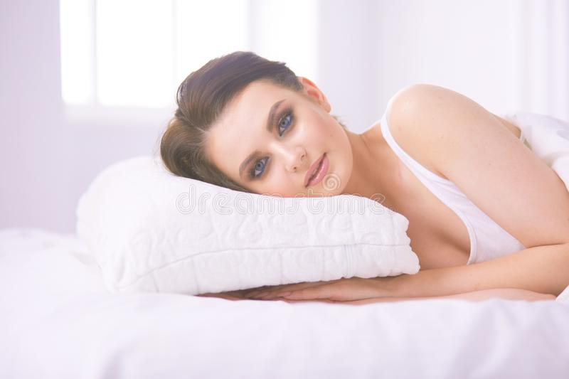 Young beautiful woman lying in bed. royalty free stock photo