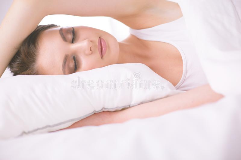 Young beautiful woman lying in bed. stock images