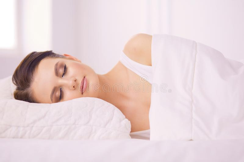 Young beautiful woman lying in bed. stock photography