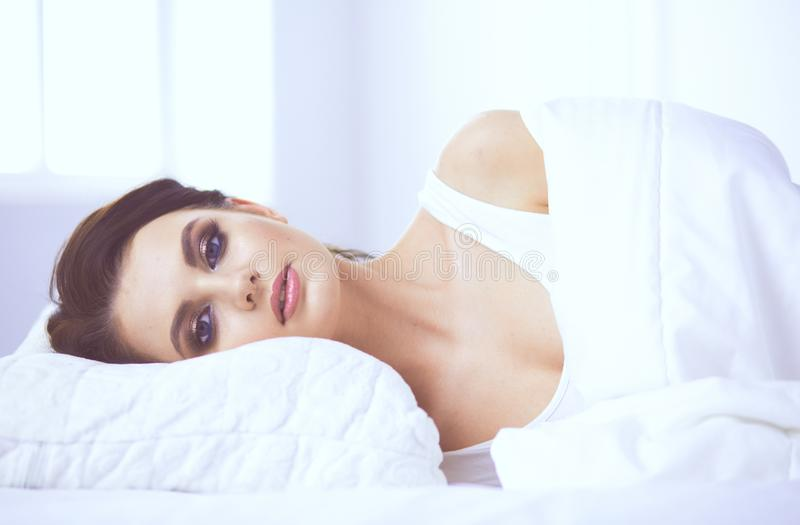 Young beautiful woman lying in bed. royalty free stock photography