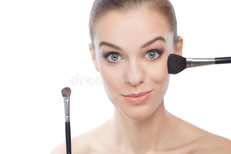 Young beautiful woman make-up, over white background stock photography