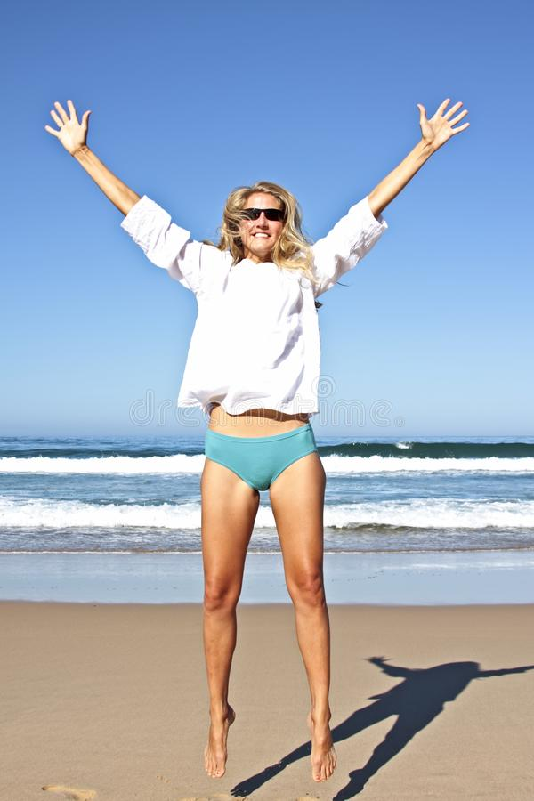 Download Young Beautiful Woman Making A Jump In The Air Stock Image - Image: 11329979