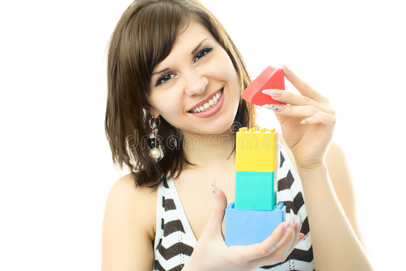 Download Young Beautiful Woman Making A Toy House Stock Image - Image: 7979043