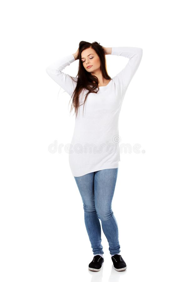Young beautiful woman massaging her own hairs stock image