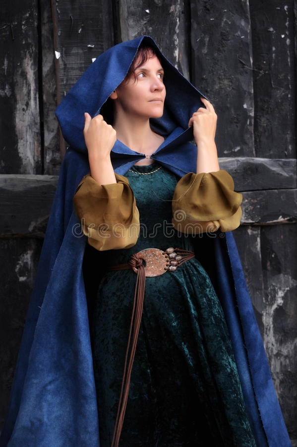 Young beautiful woman in a medieval costume royalty free stock photos