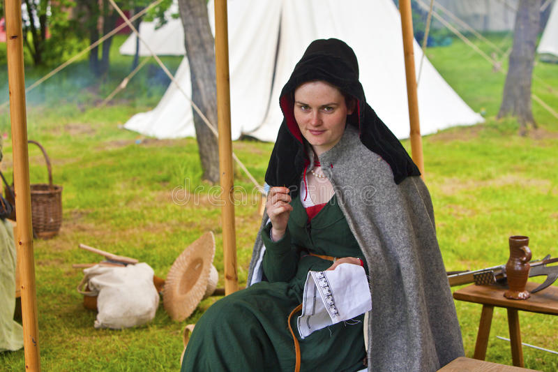Download Young Beautiful Woman In A Medieval Costume Sewing. Editorial Stock Photo - Image: 33165873