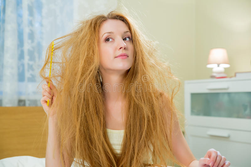 Young beautiful woman with messy hair stock photo