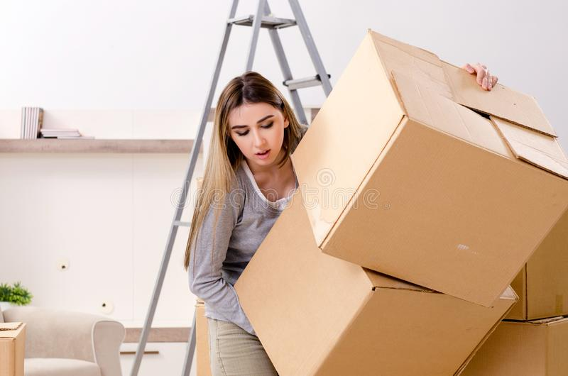The young beautiful woman moving to new flat stock photo