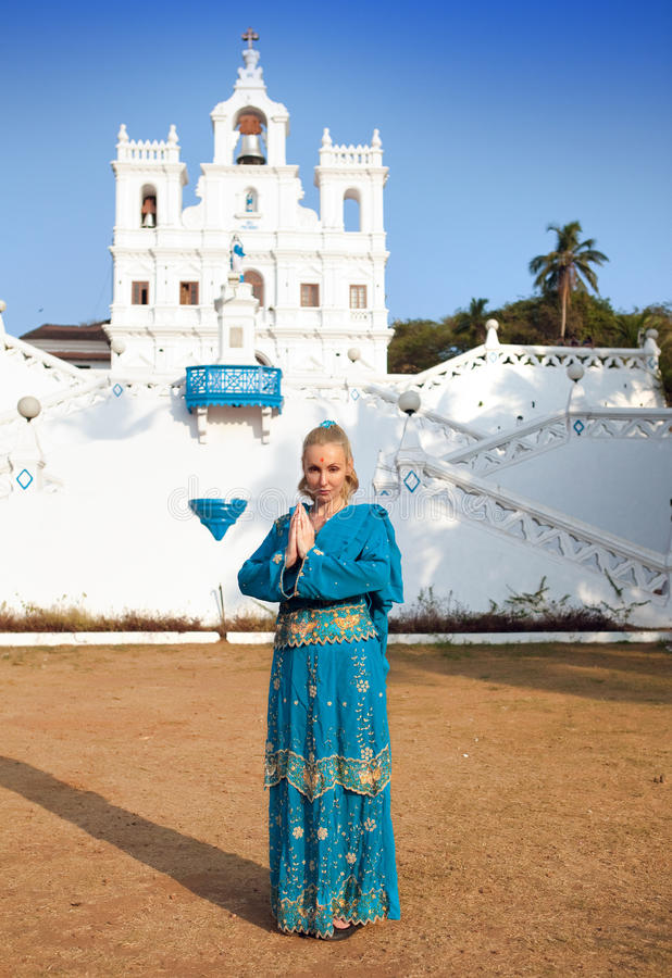 Young beautiful woman in national Indian clothes near the Catholic temple, Goa stock photo