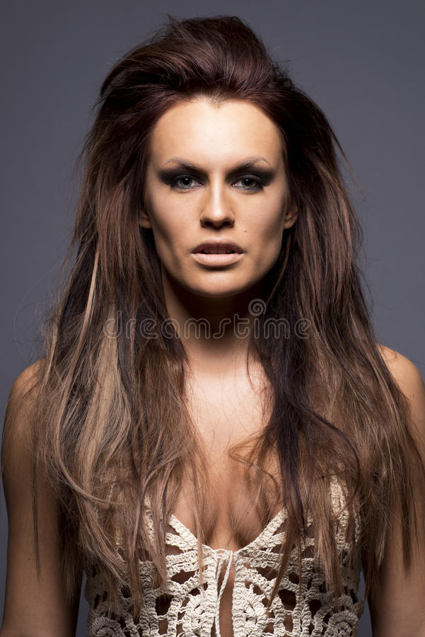 Young woman with hair extensions. royalty free stock photography