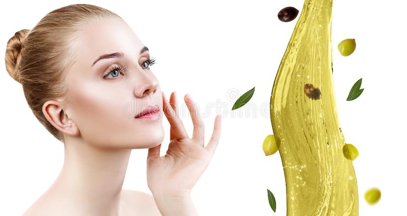 Young beautiful woman near splash of olive oil. royalty free stock photos