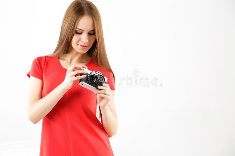 Young beautiful woman with an old camera. stock photos