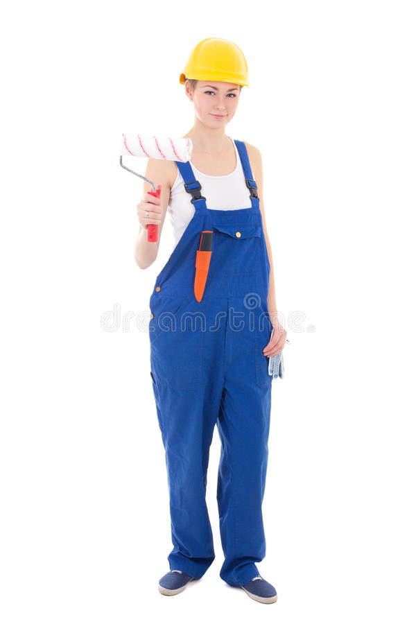 young beautiful woman painter in blue coveralls and yellow helmet isolated on white stock images