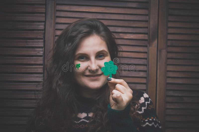 young beautiful woman with paper cut green leaf of clover in hand royalty free stock photos