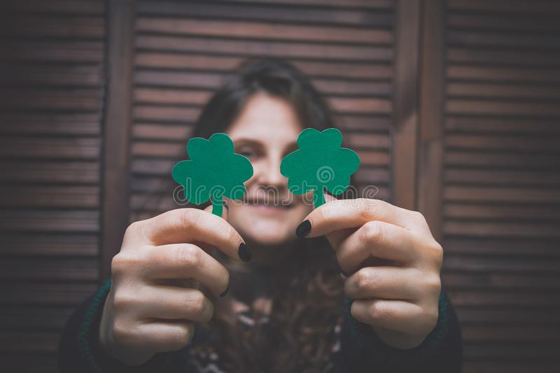 young beautiful woman with paper cut green leaf of clover stock photos