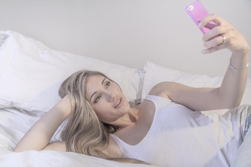 Young beautiful woman with phone royalty free stock images