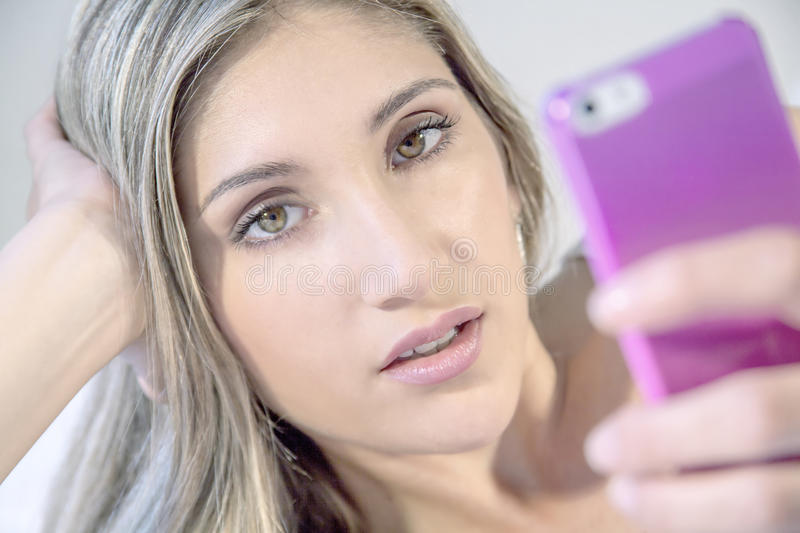 Young beautiful woman with phone royalty free stock photos