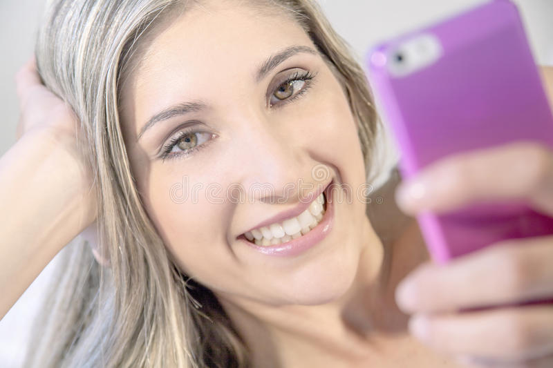 Young beautiful woman with phone royalty free stock photo