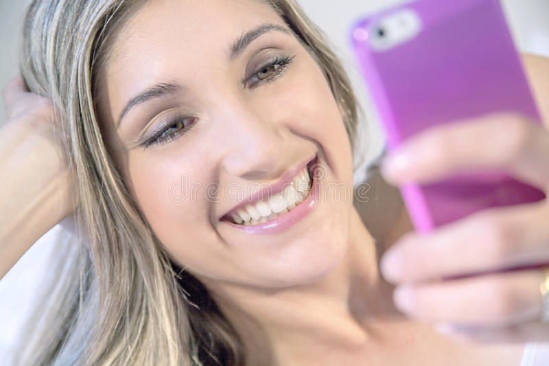 Young beautiful woman with phone stock image