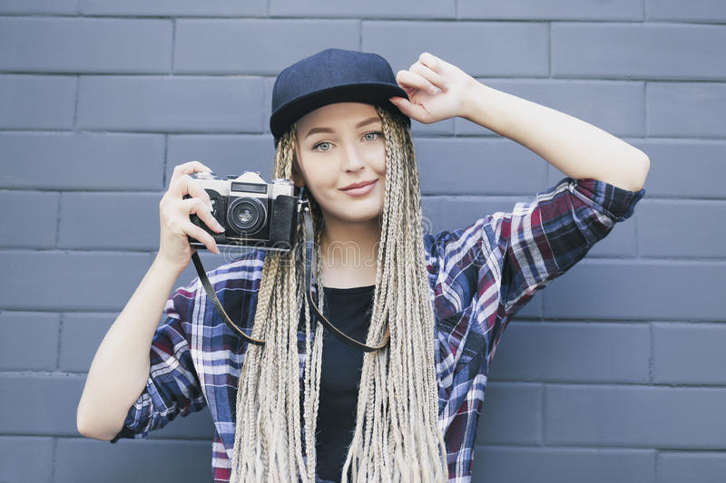 Young beautiful woman photographer is holding the camera stock image