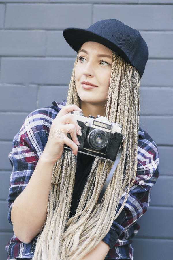 Young beautiful woman photographer holds the camera royalty free stock photo