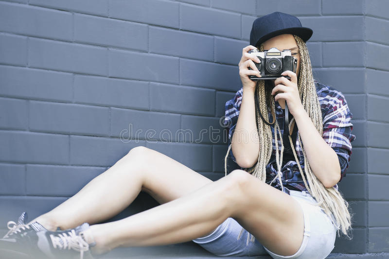Young beautiful woman photographer is taking a photo. stock images