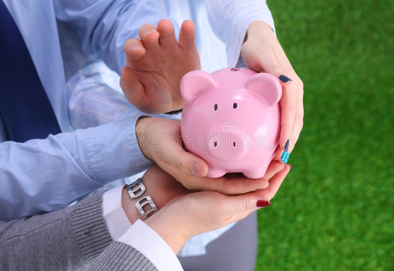 Young beautiful woman with piggy bank,. On white background royalty free stock photo