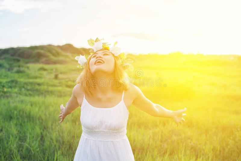 Young beautiful woman playful and enjoying with fresh air at meadows royalty free stock photo