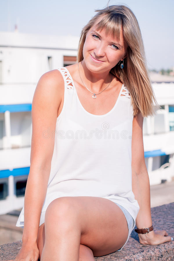 Young beautiful woman in port stock image