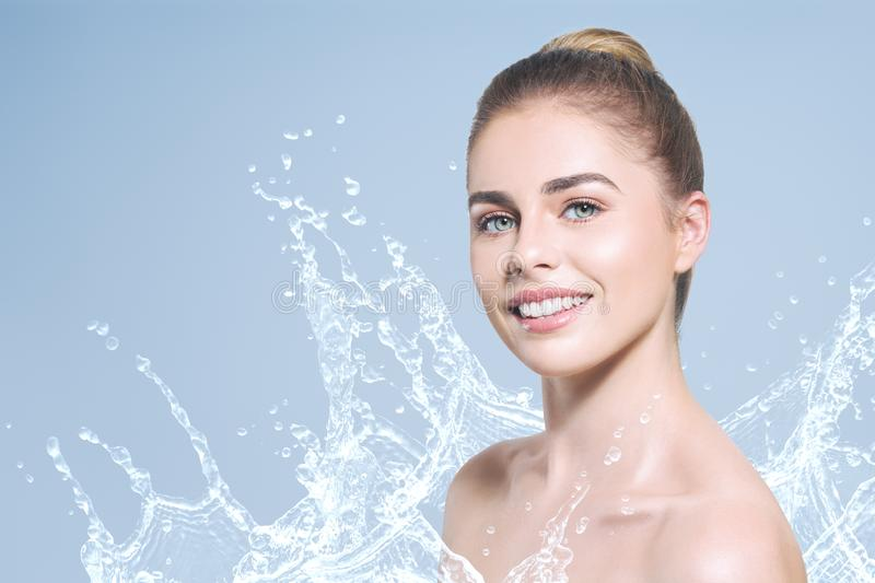 Young beautiful woman portrait with water splash royalty free stock image