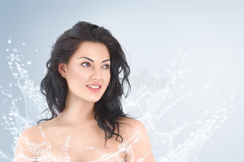 Young beautiful woman portrait with water splash stock photos